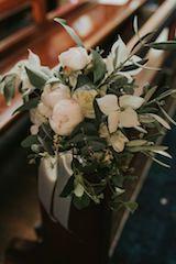 A posy for the church pew of eucalyptus gum foliage, David Austin roses, olive branches, and dogwood foliage Floreat | Wedding Flowers | Church Flowers | Rustic Wedding Flowers | Relaxed Wedding Flowers | Sydney Florist  https://floreatfloral.com.au