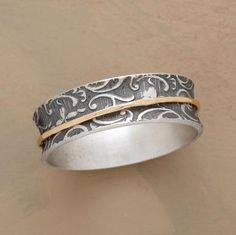 SCROLLED SPINNER RING -- Fancifully scrolled and oxidized, our sterling silver ring harbors a free-floating band of 14kt gold. Handcrafted. Whole sizes 5 to 9. This ring is licensed under U.S. patent nos. 6,497,117 and 6,395,732.