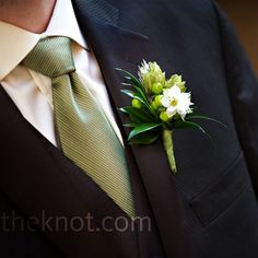 I like hops a lot.  And of course, the hypericum berries.    Sean and his groomsmen wore boutonnieres inspired by Sean's love for beer. They included pieces of barley with hops and hypericum berries.