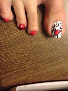 Lovely hand drawn nail art.