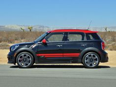 2014 Mini Cooper Countryman John Cooper Works  For 2014, you can add John Cooper Works Packages ($3,750) to a Cooper S model, giving the car the same look without the same hardware.
