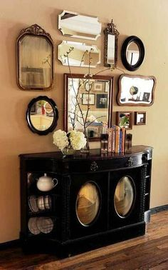 I am totally smitten by this awesome sideboard and fabulous mirror display - beautiful!