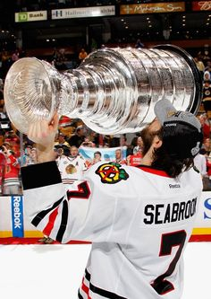 BOSTON, MA - JUNE 24: Brent Seabrook #7 of the Chicago Blackhawks hoists the Stanley Cup after his team defeated the Boston Bruins 3-2 in Game Six of the 2013 Stanley Cup Final at TD Garden on June 24, 2013 in Boston, Massachusetts. The Chicago Blackhawks won the series 4-2 to win the Stanley Cup. (Photo by Dave Sandford/NHLI via Getty Images)