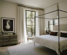 Near Tel Aviv, Israel, designer Kevin Spearman celebrates the worldly charm of this Tuscan-style villa with a touch of American ease. The contemporary white furnishings and art of this guest bedroom e Bedroom Color Schemes, Bedroom Colors, Bedroom Decor, Bedroom Ideas, Serene Bedroom, Bedroom Chair, Bedroom Designs, Bedroom Inspiration, Colour Schemes