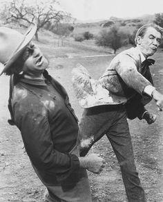 James Stewart belts John Wayne