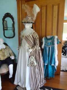 Just prior to the French Revolution, and in contrast to extravagant court fashions, ordinary clothing began to be made more 'simple' and comfortable. A variety of informal jackets began making their appearance, and by the last decade of the century, women has discarded all constructed and boned hoops and favored a softer look. A sheer silk organza kerchief adds to the 'pouter pigeon' bodice effect.