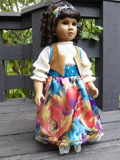 This too is a separate outfit, just modeled by the 23 inch doll that's wearing it.  It's a Roma style outfit, underskirt, blouse, skirt, vest, stretch sequin belt and matching headdress, showing off a gorgeous watercolor satin for the skirt.  The vest is superfine corduroy, lined in turquoise satin.  The undies are crinkle cotton.  Doll is barefoot.  Beautiful bead and copper dangles on the headband.  Great for Halloween!