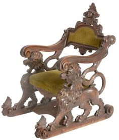 Carved Walnut Fantasy Lion Chair. Heavily carved chair has a sleigh style