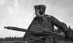 A Non-Political and a Non-Profit site to explore the role and history of the Waffen-SS in World War II for historical research and documentation. German Soldier, German Army, Mg34, Prinz Eugen, Ww2 Photos, Holocaust Memorial, Battle Tank, Military Photos, Red Army