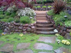 walnut creek brickyard flagstone moss rock patio. Maybe in my backyard!