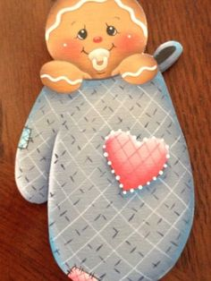 Baby in blue mitton gingerbread magnet