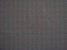 PRICE IS PER HALF METRE.100% cotton, made in Japan.Beautiful mid-weight fabric in warm brown with running stitches to make a cross pattern in red and teal. Great texture.Lovely for clothing, light home decoration or bags.110cm wide