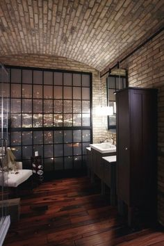 love the frosted window wall combined with dark wood floors. very masculine