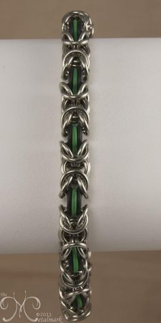 Byzantine bracelet made with EPDM rubber rings Rubber rings are latex free and very resilient to heat and the elements making them long lasting. Combine the EPDM rubber rings with one of Brass, Bronze, or Stainless Steel rings for a clasp-less bracelet. Shown in 3 ring byzantine weave with Black and Green EPDM and Stainless Steel.