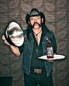LEMMY KILMISTER of MOTORHEAD with JACK DANIELS WHISKEY . HEAVY METAL T-SHIRTS and METALHEAD COMMUNITY BLOG. The World's No:1 Online Heavy Metal T-Shirt Store & Metal Music Blog. Check out our Metalhead Clothing and Apparel Store, Satanic Fashion and Black Metal T-Shirt Stores; https://heavymetaltshirts.net/