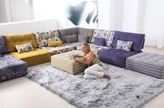 I need a temporary sort of floor seating like this to appease my bf who doesn't want to splurge on a sofa before we move. I need to find a way to do something like this but affordably and that way I can burn his black leather couch.