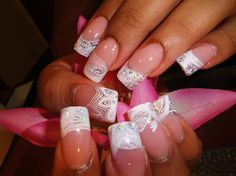 Young nails cover pink , sculpted with forms .Clear acrylic with Mylar or ice pieces .Then nails stamping with designs from Chez-Delaney .com XL plates serioes C