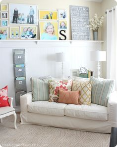 I like that this couch is on an angle with a table and lamps behind it. Very cozy look and different.