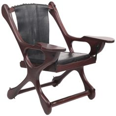Don Shoemaker Rosewood and Leather Lounge Chair | From a unique collection of antique and modern lounge chairs at http://www.1stdibs.com/furniture/seating/lounge-chairs/