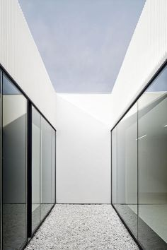 Clean architecture, large glass windows and white walls by Josep Ferrando _