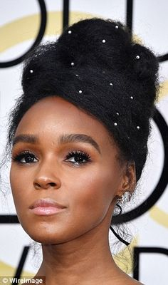No hidden figures here! Hairstylist Nikki Nelms gave Janelle Monáe, 31, a 'corseted updo' that she accessorized with diamonds and pearls