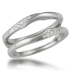 Carved Branch Asymmetrical Diamond Enhancer - This unusual wedding band was designed to wrap around the Carved Branch Engagement Ring, but may be customized to fit other engagement rings. It features flush set accent diamonds. Ideal cut diamonds.