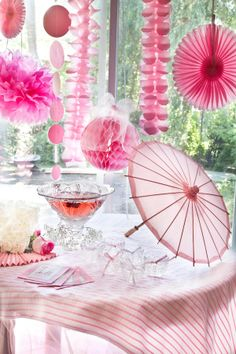 Pink party decorations - romantic display  of paper pom-poms, honeycomb garlands, flower fans and balls - gorgeous!