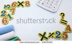 Numbers and symbols with calculator, chalks, and magic pens