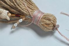 homemade tassels are a wonderful way to add an extra special touch to a gift — wrapped around the neck of wine bottle or bag of coffee beans. I generally make them from jute twine or cotton … Fabric Flower Tutorial, Fabric Flowers, Resin Crafts, Yarn Crafts, How To Make Tassels, Making Tassels, Burlap Christmas Tree, Tassel Jewelry, Diy Tassel