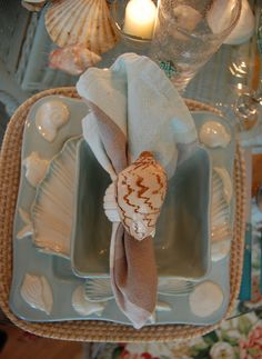 Beach Themed Tablescape with shell plates and shell napkin ring holders from between Naps on the Porch.