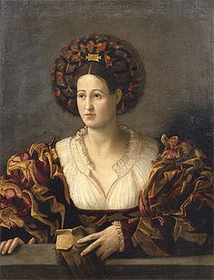 Shaped patchwork in the bodice and sleeves in addition to alternating colors in the baragoni  Paolo CAVAZZOLA  Verona 1486 – 1522    Portrait of a lady [Ritratto di gentildonna] c.1515-17  oil on canvas  96.4 (h) x 74.2 (w) cm Accademia Carrara, Bergamo
