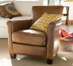 Pottery Barn Irving leather arm chair... smaller silhouette than your typical club chair. This purchase is actually happening, along with the PB Cameron sofa! :)