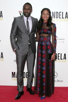 Mandela: Long Walk to Freedom premiere, New York - November 14 2013  Naomie Harris - pictured with her co-star Idris Elba - teamed a Valentino dress with Christian Louboutin heels and a Jimmy Choo clutch.