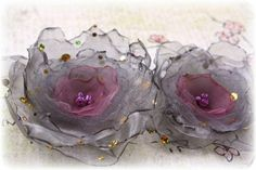 DIY: Blooms made by Gabrielle Pollacco.simply cut random size circles from netting and organza, melt edges in a candle flame, stitch together. add beading to center. Organza Flowers, Cloth Flowers, Diy Flowers, Fabric Flowers, Paper Flowers, Fabric Ribbon, Textile Jewelry, Fabric Jewelry, Smocking