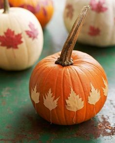 Leafy look: For this easy fall craft, glue your favorite dried leaves on pumpkins in a variety of patterns.