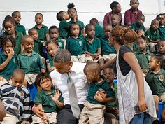 This kid has game. >> President Obama Gets Photobombed by a Young Boy : People.com