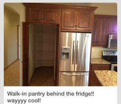 Amazing walk in pantry behind fridge