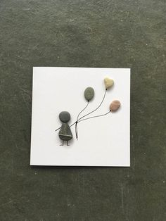 Hand made pebble art card. Person with balloons. Blank card.