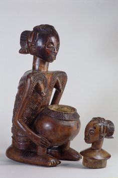"Democratic Republic of the Congo; Luba peoples Female figure with bowl Wood H. 52.7 cm (20 ¾"") The University of Iowa Museum of Art, The Sta..."