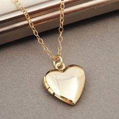 A personal favorite from my Etsy shop https://www.etsy.com/se-en/listing/247656034/heart-locket-necklace-gold-heart-locket