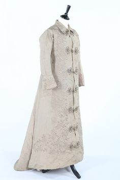 a Japanese embroidered beige silk dressing gown with frogging fasteners