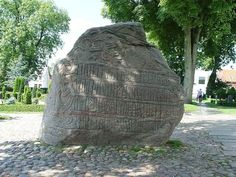 """Harald had this stone erected in memory of Gorm his father and Thyra his mother—that Harald who won all Denmark and Norway and made the Danes Christian"" -- Harald Bluetooth, btw."