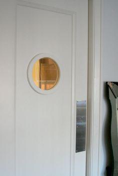 porthole swinging door, behind bar to liquor closet