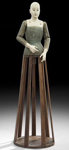 Inspiration for developing in ceramic. Large continental painted wood Santos cage doll, fourth quarter 18th century, the figure with a carefully-carved face and hands, and articulated arms