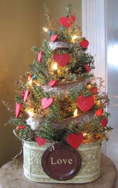 Why not take an ordinary pine tree and make a lovely Valentine Tree?  After all Pine is green all year round!