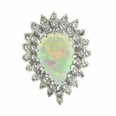 3.27 ct White Gold Opal & Diamond Ring 14 kt null http://www.amazon.com/dp/B006N9K4E4/ref=cm_sw_r_pi_dp_Qi-Utb1MV99E6GJ6