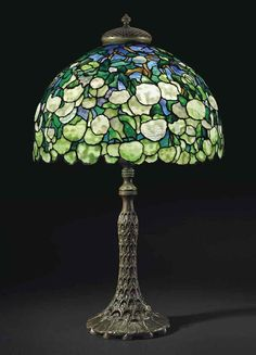 TIFFANY STUDIOS A 'SNOWBALL' TABLE LAMP, CIRCA 1905 leaded glass, patinated bronze.