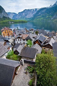 Hallstatt    Hallstatt, Austria. - Large DOP, repeating patterns in shallow DOP with lines leading to background, faded mountains in distance gives the place content and interest - color scehme mostely blue-grey with pops of vivid color