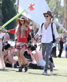 2014: Zombie walks through the grounds with Austin Butler: | A History Of Vanessa Hudgens At Coachella