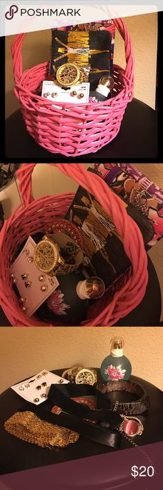 Gift basket I put together a little gift basket. Includes 3 choker necklaces 2 black and one gold, earrings, 2 bracelets one zebra print and one silver and pink, Britney Spears fragrance, xoxo cheetah print watch,4 ipsy cosmetic bags, and a little red mirror. Let me know if you're interested❤️ Diy gift basket  Other